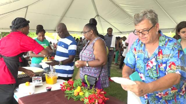 Patrons partaking in the Nevisian Chef Mango Fest at Oualie Beach on July 09, 2017