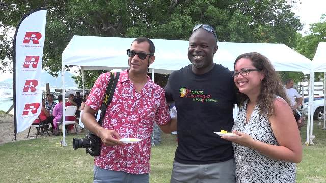 Greg Phillip, Chief Executive Officer of the Nevis Tourism Authority with visiting journalists at the Nevisian Chef Mango Fest at Oualie Beach on July 09, 2017