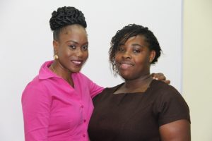 Medical University of the Americas/Nevis Island Administration Scholarship recipients (L-r) Oresia Stapleton and Yolinda Liburd at the Legal Department's conference room on July 05, 2017