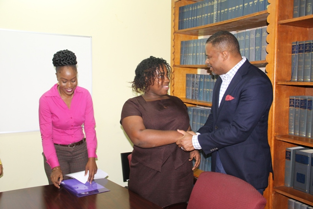 Hon. Mark Brantley, Deputy Premier of Nevis and Minister of Health interacting with the 2017 Medical University of the Americas/Nevis Island Administration Scholarship recipients at the Legal Department conference room on July 05, 2017