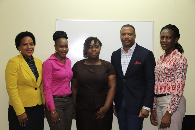 (L-r) Mrs. Nicole Slack-Liburd, Chairperson for the Medical University of the Americas/Nevis Island Administration Scholarship Committee and Permanent Secretary in the Ministry of Health, Scholarship awardees Oresia Stapleton and Yolinda Liburd Hon. Mark Brantley, Deputy Premier of Nevis and Minister of Health and Committee Member Mrs. Shelisa Martin-Clarke at the Legal Department conference room on July 05, 2017