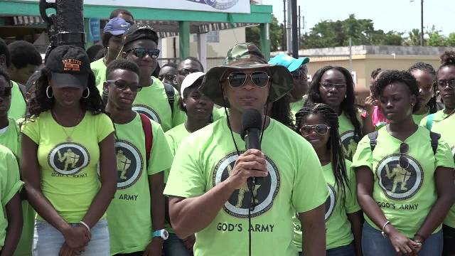 Youth Pastor Colin Gunthrope of the New Life Baptist Church in Tortola at the Charlestown Pier on July 03, 2017, leading a group of youth members of his church