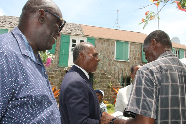 "Dr. Whitman Browne, Nevisian author of three publications on the M.V, Christena Disaster in 1970 (right) with Premier of Nevis Hon. Vance Amory (middle) at the Memorial Service at the Alexander Hamilton Museum Grounds on August 01, 2017, commemorating the 47th anniversary of the disaster. Survivor Oswald ""Ossie"" Tyson looks on"