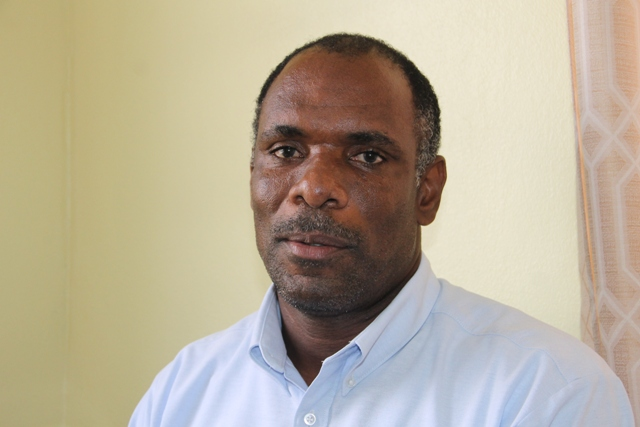 Colin Dore, Permanent Secretary in the Ministry of Finance in the Nevis Island Administration