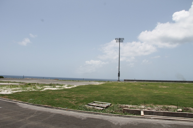 A section of the four-pole lighting system installed and commissioned by Mosco Sports Lighting in the United States of America and a section of the grass area at the Mundo Track Project at Long Point