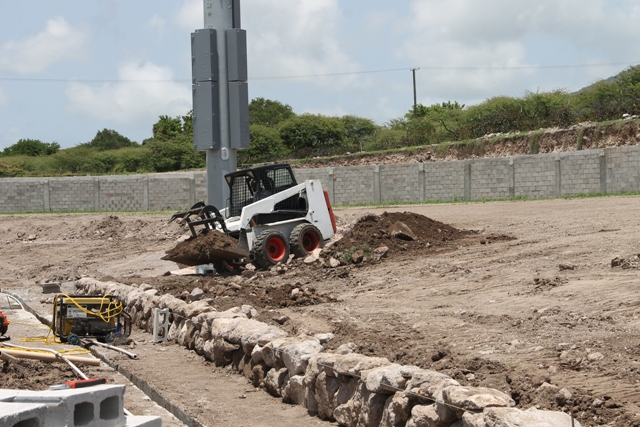 A Nevisian stone wall under construction on August 22, 2017, at the eastern section of the Mundo Track facility at Long Point