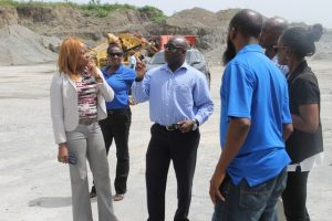 Hon. Alexis Jeffers, Minister of Housing and Land on Nevis (middle) speaks to Mrs. Elreter Sampson-Browne, General Manager of the National Housing Corporation in St. Kitts and her team, during a tour of the Nevis Island Administration-owned quarry at New River on October 18, 2017