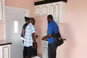 Technical staff from the National Housing Corporation in St. Kitts taking a close look at the finishing in a newly constructed affordable house at the Nevis Housing and Land Development Corporation's Cedar View Development Project at Maddens on October 18, 2017