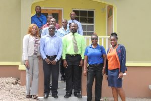 Members of the National Housing Corporation in St. Kitts including Mr. Valentine Lindsay, Chairman of the National Housing Corporation ( front row third from right), General Manager Mrs Elreter Sampson-Browne (front row left) and the Nevis Housing and Land Development Corporation on a tour at the Cedar View Development Project at Maddens on October 18, 2017, led by Hon. Alexis Jeffers, Minister of Housing and Lands on Nevis (front row second from left) and Dexter Boncamper, Manager of the Nevis Housing and Lands Development Corporation (back row left)