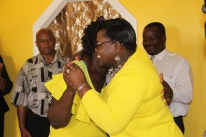 New home owner Stephanie Freeman (left), bursting with joy, warmly embraces Hon. Hazel Brandy-Williams, Junior Minister in the Ministry of Social Development (right), while presenting her with keys to her new three-bedroom home at the New River Housing Project from on October 19, 2017