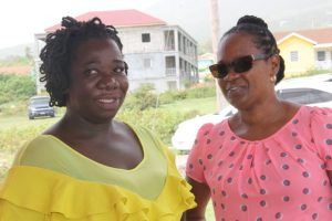 Ms. Stephanie Freeman, new home owner having a light moment with her Mrs. Kim Sing, Social Case Worker in the Department of Social Development on October 19, 2017, soon after she was presented with the keys as part of the Ministry of Social Development's Community Home Assistance Programme