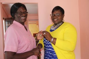 Hon. Hazel Brandy-Williams, Junior Minister in the Ministry of Social Development in the Nevis Island Administration (right) hands over the keys to Mrs. Yvonne Stanley of her newly renovated home at Fig Tree on October 19, 2017