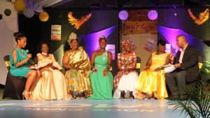 The participants in the first ever Miss Nevis Senior Pageant at the Nevis Cultural Complex on October 28, 2017, (l-r) Ms. Deloris Richardson from the St. Pauls Parish, Ms. Catherine Tyson from the St. Thomas Parish, Ms. Yvonne Rogers from the St. Georges Parish and Ms. Sarah Browne from the St. James Parish having a chit chat with host (extreme right) Mr. Eric Evelyn and hostess (extreme left) Ms. Charmaine Howell