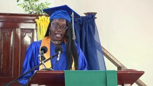 Ms. Kervincia Webbe, top student in the Caribbean Examination Council's Caribbean Secondary Education Certificate (CSEC) and Valedictorian of the Gingerland Secondary School's (GSS) Graduating Class of 2017 delivering her valedictory speech at the school's 44 annual graduation ceremony at the Gingerland Secondary School on November 23, 2017