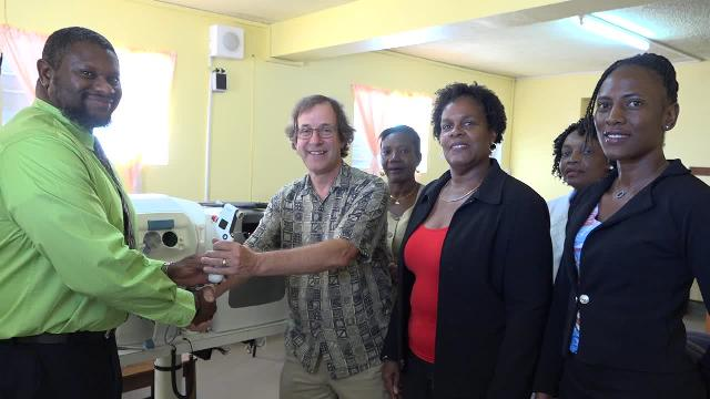 (L-r) Mr. Donavan Herbert, Manager in the Research and Statistics Department at the St. Christopher and Nevis Social Security Board handing over eye care equipment to Dr. Raymond Hubbe, Specialist and Director of the Nevis Eye Care Programme, Nurse Ermine Jeffers, Coordinator of Community Nursing Services, Dr. Judy Nisbett, Medical Officer of Health on Nevis, Nurse Elvereene Bussue, Head of the Cotton Ground Health Centre and Mrs. Shelisa Martin-Clarke, Acting Permanent Secretary in the Ministry of Health at the handing over ceremony at the Alexandra Hospital on November 22, 2017