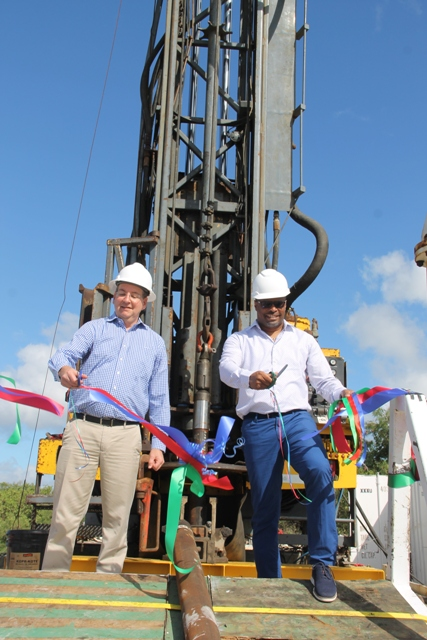 (l-r) Mr. Dan Pfeffer, President of the Nevis Renewable Energy International (NREI) and Hon. Mark Brantley, Acting Premier of Nevis cut the ribbon to signal the start of drilling a test well at Hamilton Estate on November 22, 2017