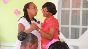Mrs Garcia Hendrickson (left), outgoing Coordinator of the Department of Social Services Senior's Division in the Ministry of Social Development on Nevis at a Valentine's Day celebration hosted by the Ministry of Social Development in the Nevis Island Administration for seniors in February 2016 (file photo)