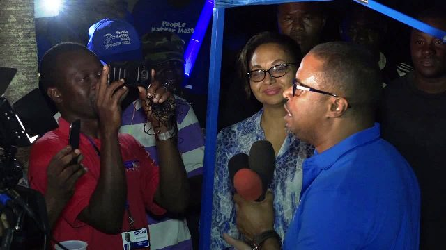 Premier of Nevis Elect Mr. Mark Brantley delivering his victory speech outside the party headquarters on Government Road in Charlestown on December 19, 2017, following his party's victory at the Nevis Island Assembly elections on December 19, 2017. His wife Sharon looks on
