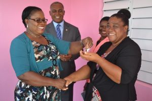 Mrs. Florence Smithen, Education Officer responsible for Early Childhood Education in the Department of Education, hands over the keys to the newly renovated and expanded Gingerland Preschool to Supervisor Mrs. Pamella Elliott-Lawrence on December 12, 2017, while Hon. Vance Amory, Premier of Nevis and Minister of Education and Mrs. Palsy Wilkin, Principal Education Officer in the Department of Education look on