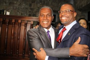 Premier of Nevis Hon. Mark Brantley (right) with immediate past Premier of Nevis Hon. Vance Amory embrace soon after Mr. Brantley was sworn in as premier at the High Court in Charlestown on December 19, 2017