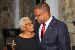 New Premier of Nevis Hon. Mark Brantley shares a tender moment with Lady Sheila Daniel who he says is a mother to him after he was sworn in as premier of Nevis at the High Court in Charlestown on December 19, 2017