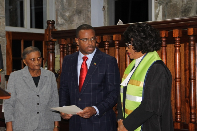 New Premier of Nevis Hon. Mark Brantley with his Instruments of Appointment in hand, moments after Acting Deputy Governor General Her Honour Mrs. Marjorie Morton (right) presented them to him at a special sitting of the High Court in Charlestown, on December 19, 2017. Her Ladyship the Hon. Justice Pearletta Lanns looks on