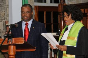 Her Ladyship the Hon. Justice Pearletta Lanns administering the Oaths of Allegiance and Secrecy to the new Premier of Nevis Hon. Mark Brantley, at a special sitting of the High Court in Charlestown on December 19, 2017