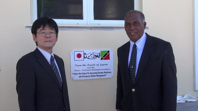 (l-r) Mr. Hideaki Fujiyama, Second Secretary at the Embassy of Japan to St. Kitts and Nevis and Hon. Vance Amory, Premier of Nevis moments after unveiling a plaque on the Albertha Payne Community Centre at Bath Village recently, at the closing ceremony of the Japan funded Improving Disaster Resilience and Emergency Shelter Management Project on Nevis