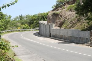 A section of the 300 feet retaining wall constructed at Fenton Hill to mitigate the occurrence of rock fall hazard was constructed in the in the Improving Disaster Resilience and Emergency Shelter Management Project funded by the government and people of Japan