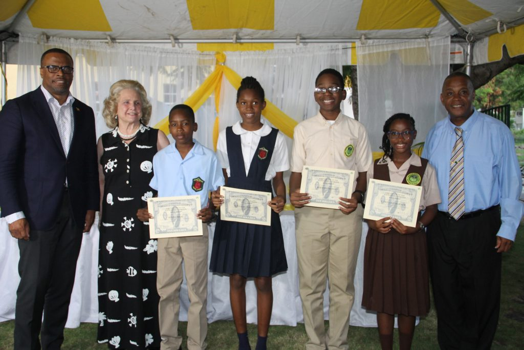 Premier of Nevis Mark Brantley, Mrs. Mary Anne Hamilton Great-great grand daughter of Alexander Hamilton, Mr. Kegel Isaac, Ms. Jonnicia Williams, Mr. Kirmani Hanley, Ms. Kimalijah Warner and Hon. Eric Evelyn - Minister of Youth and Community Development at the Alexander Hamilton Scholarship Award Ceremony on January 12, 2018, at the Alexander Hamilton Museum grounds