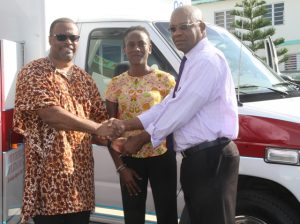 Hon. Mark Brantley, Minister of Foreign Affairs, Premier of Nevis and Minister of Health, hands over keys to an ambulance from His Excellency Sir Kutayba Alghanim, Consul General to St. Kitts and Nevis to Dr. Cardell Rawlins, Medical Chief of Staff at the Alexandra Hospital on January 13, 2018