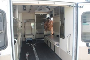 Hon. Mark Brantley, Premier of Nevis and Minister of Health takes a first-hand look at the interior of the ambulance gifted by His Excellency Sir Kutayba Alghanim, Consul General to St. Kitts and Nevis in New York