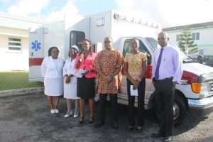 (l-r) Mrs. Jessica Scarborough, Assistant Matron at the Alexandra Hospital; Aldris Pemberton-Dias, Matron at the Alexandra Hospital; Ms. Marlene Jeffers, Acting Hospital Administrator; Hon. Mark Brantley, Minister of Foreign Affairs, Premier of Nevis and Minister of Health; Mrs. Shelisa Martin-Clarke, Acting Permanent Secretary and Health Planner in the Ministry of Health and; Dr. Cardell Rawlins, Medical Chief of Staff at the Alexandra Hospital at the handing over ceremony of an ambulance from His Excellency Sir Kutayba Alghanim, Counsel General to St. Kitts and Nevis in New York
