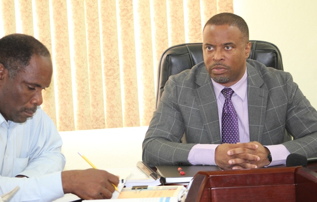 Hon. Mark Brantley, Premier of Nevis (right) and Minister of Finance and Mr. Colin Dore, Permanent Secretary in the Ministry of Finance at the start of a three-day Budget Estimates meeting on January 09, 2018 at the Ministry of Finance conference room