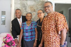 "Senator Wendy Phipps, Minister of State in the Ministry of Health in the Federal Government (second from right) with the Federation's oldest living centenarian Celian ""Martin"" Powell at her 106th birthday celebration on January 19, 2018, at the Flamboyant Nursing Home. She is flanked by (l-r) Hon Eric Evelyn Minister of Community Development on Nevis, Her Honour Mrs. Marjory Morton, Acting Deputy Governor General and Hon. Mark Brantley, Premier of Nevis"