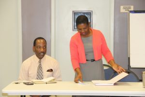 (l-r) Mr. Kevin Barrett, Permanent Secretary in the Ministry of Education on Nevis and Mrs. Palsy Wilkin, Principal Education Officer in the Department of Education at the Education Officers Appraisal for Growth and Development Programme three-day training workshop at the Nevis Disaster Management Department conference room of January 10, 2018