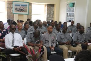 A section of police officers stationed at the Nevis Division of the Royal St. Christopher and Nevis Police Force listen attentively at the New Year Celebration Service of the Royal St. Christopher and Nevis Police Force at the Charlestown Police Station's Recreational Room on January 03, 2018