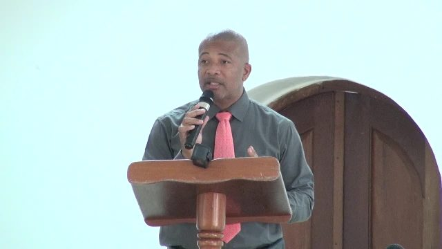 Hon. Spencer Brand, Minister of Labour, Public Works, Physical Planning, Posts and Environment in the Nevis Island Administration delivering remarks at a recent meeting at the St. Pauls Anglican Church Hall, with members of the Cabinet and Senior Civil Servants