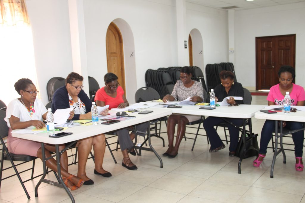 (l-r) Ms. Vera Herbert, enumerator; Ms. Tracy Parris, Community Development Officer; Mrs. Lydia Claxton, Community Development Officer; Ms. Malva Rawlins, Community Development Officer; Ms. Glenda Claxton, Community Development Officer; Ms. Tasha Parry, Community Development Officer at the workshop regarding the CFYR Program survey, held at the St. Paul's Anglican Church Hall on February 01, 2018