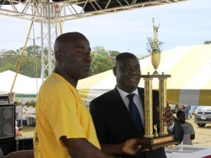 Mr. Mclean Moore of the Indian Castle Fisher Folk Association receives an award on behalf of the association named top Fisher for 2017 from Minister of Agriculture Hon. Alexis Jeffers at the Department of Agriculture at the at its 24th Annual Agriculture Open Day Opening Ceremony on March 22, 2018 at the Villa Grounds in Charlestown