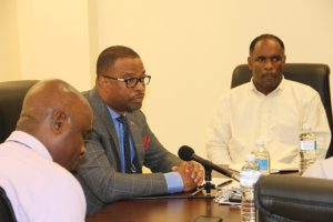 Hon. Mark Brantley, Premier of Nevis and Minister of Finance addressing members of the Nevis Chapter of the St. Kitts and Nevis Chamber of Industry and Commerce at Pinney's Estate on March 13, 2018. He is flanked by Mr. Stedmond Tross, Cabinet Secretary and Special Advisor to the Nevis Island Administration (left) and Mr. Colin Dore, Permanent secretary in the Ministry of Finance (right)