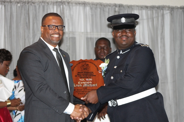 Hon. Mark Brantley, Premier of Nevis and Minister of Security presents Constable of the Year award to Constable Leon Michael, at the Royal St. Christopher and Nevis Police Force, Nevis Division's 18th annual Constable's Award Ceremony and Dinner on March 10, 2018, at the Occasion's Entertainment Arcade at Pinney's Estate