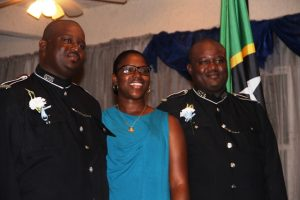 Constable of the Year in the Royal St. Christopher and Nevis Police Force, Nevis Division Constable Leon Michael (l) with his twin brother Constable Cleon Michael (r) and their younger sister Ms. Meisha Michael at the 18th annual Constable's Award Ceremony and Dinner on March 10, 2018, at the Occasion's Entertainment Arcade at Pinney's Estate