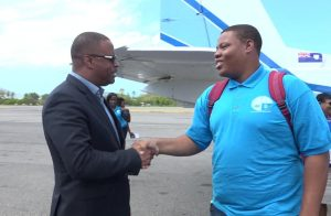 Premier of Nevis and Minister of Education Hon. Mark Brantley welcomes Kjel Smithen Best Speaker for one of the debates at the 46th Leeward Islands Debating Competition on his arrival at the Vance W. Amory International Airport on March 05, 2018