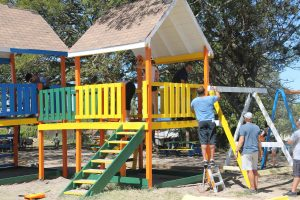 Members of the Galderma Group painting and repairing the play area as part of a gift to the Ivor Walters Primary School at Brown Hill on February 28, 2018