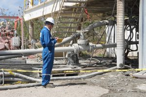 Mr. Robert Stacy, Senior Reservoir Engineer with GeothermEX carries out a reading at the geothermal test well at Hamilton on March 16, 2018