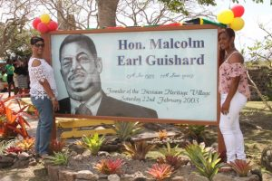 Mrs. Yvonne Guishard (left), widow of the late Mr. Malcolm Guishard, Former Minister of Culture on Nevis and their daughter Shenelle moments after signage was unveiled in his honour at a ceremony marking the 15th anniversary of the Nevisian Heritage Village in Gingerland on February 22, 2018