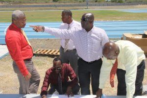 (Standing l-r) Hon. Spencer Brand, Minister of Communication and Works, Hon. Eric Evelyn, Minister of Youth and Sports, Acting Premier of Nevis Hon. Alexis Jeffers and Cabinet Secretary Mr. Stedmond Tross with Mr. Kevin Barrett, Permanent Secretary in the Ministry of Education (front) checking on progress at the Mondo Track project at Long Point on March 20, 2018