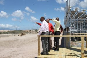 Members of the Nevis Island Cabinet led by Acting Premier Hon. Alexis Jeffers and Mr. Kevin Barrett, Permanent Secretary in the Ministry of Education looking at construction works of a parking lot while checking on progress at the Mondo Track project at Long Point on March 20, 2018