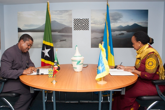 (l-r) His Excellency Dr. Kevin M. Isaac, St. Kitts and Nevis High Commissioner to the United Kingdom and Her Excellency Ms. Yamina Karitanyi, High Commissioner of Rwanda to the United Kingdom sign mutual the visa waiver agreement in London on behalf of their governments on April 26, 2018
